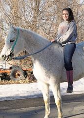 Pretty Girl On A  Horse (wyojones) Tags: wyoming bighorncounty cowley bighornbasin sky girl woman horse street bareback riding horseback boots gray white brunette beautiful lovely cute ponytail smile