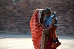 Just the Two of Us (Pedestrian Photographer) Tags: fatehpur sikri india mom mother baby phone iphone selfie brigh color orange sari woman family child little fave light shoes wall ancient uttar pradesh indian tourists visit visiting faces shadow bracelets togetherness camera