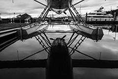 Belly of the Beast (otterdrivernw) Tags: xt2 fujifilm fuji dhc3 dehavilland marina water reflections seaplanesfloatplanes floatplane seaplane monochrome blackwhite