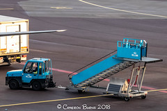 """Tug and Boarding Stairs (IMG_2455) (Cameron Burns) Tags: tug boardingstairs boarding stairs klm kl blue amsterdam schiphol airport amsterdamschipholairport """"amsterdam schiphol"""" ams eham airfield aviation aerospace airliner aeroplane aircraft airplane plane canoneos80d canoneos eos80d canon80d canon eos 80d netherlands holland dutch haarlemmermeer """"luchthaven luchthaven europe action"""