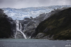 Glacier Waterfall ([CamCam]) Tags: ngc seascape beagle channel beaglechannel chile sout america southamerica ice snow snwoy mountain mountains cloud clouds cloudy sea water waves blue pure glacier melt melting waterfall waterfalls falls envisionthing envision thing camcam