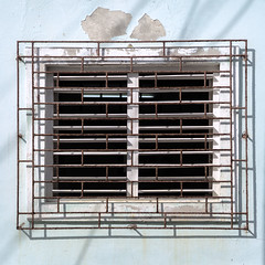 Window grates are necessary to thwart break and enter, a common crime in Cuba. (Gerald Lau) Tags: holguin cuba 2019 window grate breakandenter crime