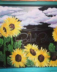Sunflowers in Window (booboo_babies) Tags: flowers painting window sunflowers bakery lubbocktexas art yellow floral