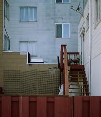 Sunset District // San Francisco (bior) Tags: pentax645nii pentax645 pentax 645 mediumformat 120 cinestill50d cinestill sanfrancisco sunsetdistrict house home stairs fence windows