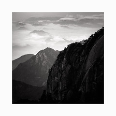 Deep (Frans van Hoogstraten) Tags: huangshanmountain clouds mountain peaks blackandwhite blackwhite view landscapephotography landscape china contrast anhui calmness depth infinity nature peak rock silence trees valley winter zen