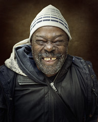 Ron (mckenziemedia) Tags: man face smile portrait portraiture coat stockingcap hat chicago city urban street streetphotography people homeless homelessness