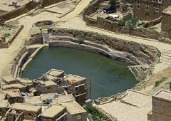 Water Cistern In Hababa, Yemen (Eric Lafforgue) Tags: arabia arabiafelix arabianpeninsula architectural architecture cistern colourpicture day drinkingwater drought highangleview historical history horizontal nopeople placeofinterest pool stairs step water yemen img1646 hababa