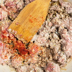 Wooden spatula in minced meat with spices thumbnail