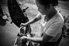 At the gas Station, Laos (pas le matin) Tags: woman portrait femme gas gasstation stationservice moto motorbike travel voyage world asia asie southeastasia bw nb blackandwhite noiretblanc monochrome canon 7d canon7d canoneos7d eos7d laos lao bolaven bolavenplateau