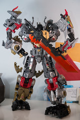DSC_9094 (Quantum Stalker) Tags: transformers takara hasbro power primes dinobots volcanicus transform dreamwave tdw upgrade kit thigh claws gold primal qc average sword weapons