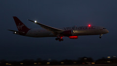 Virgin Dreamliner. (spencer_wilmot) Tags: night nightshoot nighttime vsvir vs vir virginatlantic virgin dreamliner boeingdreamliner boeing787dreamliner 787 789 7879 b787 b789 widebody twin beacon strobe engines red darksky dark plane passengerjet jet jetliner civilaviation commercialaviation lhr landing london longhaul landinggear heathrow heavy aviation aircraft airplane airliner airport arrival airside approach boeing