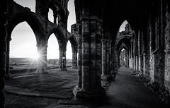 Abbey sunset (grbush) Tags: whitby sun sunset sunrise sunburst shadows architecture arch ruins religion abbey derelict abandoned yorkshire northyorkshire england bw blackwhite monochrome sonyilce7 tokinaatx116prodxaf1116mmf28