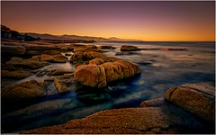 Foreshore - Bicheno (niggyl (well behind)) Tags: tasmania eastcoasttasmania water ripples sundown sunset fujifilm fujifilmxt1 fujixt1 xt1 fujinon fujinonxf165528rlm fujixf1655r xf1655r nikcollection colorefexpro4 tasmansea seascape sea coastal ocean rocks foreshore coastline cloudsstormssunsetssunrises bicheno waubsbay diamondisland seymourpoint paddyshead macleanbay longexposure theethereallongexposure nisifilters longexposurephotography 10stopndfilter devoniangranite