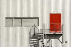 Spiral staircase and red door (Jan van der Wolf) Tags: map183287v red rood spiralstaircase wenteltrap shadow schaduwen shadows grey grijs lines lijnen door deur