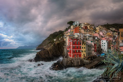 Riomaggiore (Michał.Włodarczyk) Tags: italy liguria cinque terre shore rocks village harbour sky dramatic sea water clouds light beautiful