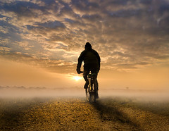 Sunrise Cyclist (adrians_art) Tags: cyclist bike transport skyclouds mistfog sunrisesunset silhouetteshadow people hobby