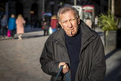 The Analogue Cigarette (Leanne Boulton) Tags: urban street candid portrait portraiture streetphotography candidstreetphotography candidportrait streetportrait eyecontact candideyecontact streetlife old man male face eyes expression mood feeling atmosphere smoke smoker smoking cigarette winter sunlight tone texture detail depthoffield bokeh naturallight outdoor light shade shadow city scene human life living humanity society culture lifestyle people canon canon5dmkiii 70mm ef2470mmf28liiusm color colour glasgow scotland uk