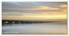 ABC_5365 (Lynne J Photography) Tags: northumberland coast seascapes sunrise water longexposure groynes outfallpipe clouds mono blackwhite pier cambois blyth rocks seatonsluice lighthouse pastel colors dawn light