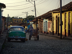 Off to Work, Morning in Trinidad, Cuba (creditflats) Tags: trinidad cuba morning goldenhour colour color horse buggy classic american car cobble cobblestone site heritage world unesco travel sunshine olympus ep5 pen street town city building house