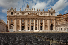 vatican city-4592 (yukkycakes) Tags: vaticancity rome italy stpetersbasilica mainfacade dome stpeterssquare chairs seats readyforpapalvisit colonnade columns saintsstatues clocks cross