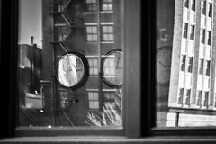 does anybody really know what time it is? (fallsroad) Tags: sigma135 sigma135art tulsaoklahoma downtown city urban scene fragment blackandwhite bw monochrome clock clocks time window glass reflections highiso