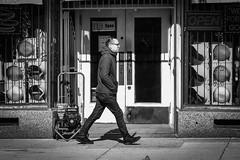 Walk With the Light (tim.perdue) Tags: walk with light traffic arrow man person figure walking candid street levs pawn shop window door storefront open sign black white bw monochrome blackandwhite mono nikon d5500 nikkor 1855mm city urban downtown sidewalk east main st columbus ohio