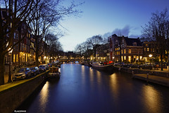 Amsterdam. (alamsterdam) Tags: amsterdam night longexposure reflection canal brouwersgracht houseboats bridge cars sky clouds architecture bikes trees
