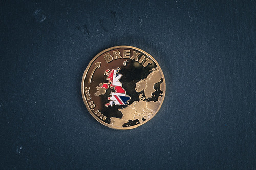Golden Brexit medal coin on a black background