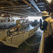 Sailors direct the mooring of a landing craft, utility in the well deck of the USS New Orleans