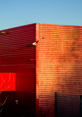 P1010712 (Patrick Hadfield) Tags: architecture blueskies industrial corrugated red