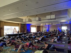 People do Frog pose at large yoga class with Schuyler Grant (Eric Broder Van Dyke) Tags: wanderlust oahu 2019 pixel3 people do frog pose large yoga class with schuyler grant