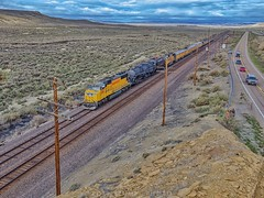Thayer Jct., Wyoming (rolfstumpf) Tags: usa wyoming thayerjct lincolnhighway us30 i80 unionpacific up4014 bigboy telegraph codeline landscape highway steamlocomotive olympus overlandroute railway railroad trains desert