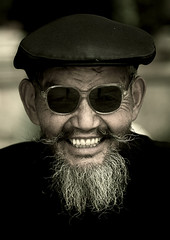Naxi Minority Man Wearing Sunglasses, Lijiang, Yunnan Province, China (Eric Lafforgue) Tags: a7870 activeseniors adult adultsonly asia beard china chineseculture colorpicture day frontview happiness lijiang lookingatcamera menonly moustache naximinority onemanonly onepeople oneperson oneseniormanonly onlymen portrait realpeople senioradult smile smiling traditionalclothing travel vertical wisdom yunnan yunnanprovince