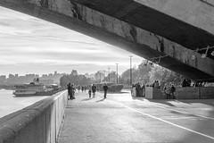Under the bridge (man_from_siberia) Tags: krasnoyarsk city bridge people embankment sunshine sunlight evening monochrome blackandwhite blackwhite autumn september siberia russia россия сибирь bnw bw чб чернобелоефото чернобелое монохром красноярск
