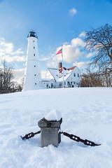 Snowy North Point Light Station (VBuckley.com) Tags: lighthouse northpointlight northpointlighthouse northpointlightstation snow white day blue bluesky cloups lowangle wideangle cpl tiffen circularpolarizer winter wisconsin milwaukee lakefront lakemichigan freshsnow americanflag america