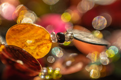 HMM! All that glitters ... (suzanne~) Tags: macromondays jewelry glitter bokeh bead necklace bauble lensbaby sol45