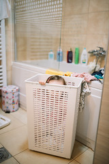 A child hiding in a laundry basket (Ivan Radic) Tags: badezimer familie kind kleinkind wäschekorb bathroom child cleaning clothing cosmetic domestic family funny game hiding humor kleinesmädchen laundrybasket looking loundry lustig playing smiling verstecken washing younggirl