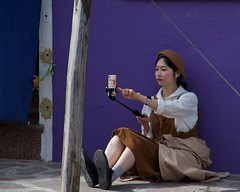 IMGP5211 Selfie (Claudio e Lucia Images around the world) Tags: burano selfie shadow tourist chinese girl lady younglady nicegirl smiling selfiestick happy pentax pentaxk3ii pentaxart pentaxlens pentaxcamera pentax18135