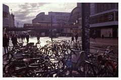 Alexanderplatz, Berlin (jmvanelk) Tags: alexanderplatz backlight sunlight aftertherain shadows bikes subway berlin germany expiredfilm analog filmisnotdead nikonf75 nikkor3570mm ektachrome100sw