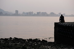 On a pier (theq629) Tags: taiwan tamsui water person pier