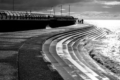 075 Promenade Walk (georgestanden) Tags: blackandwhite black white monochrome desaturated photo photography photograph bnw art picture photooftheday blackandwhitephotography bw monoart minimalism minimalist minimal minimalistic simple simplicity lessismore negativespace promenade walk walking blackpool lancashire sun sunny steps people sea water clouds silhouette seascape wave waves pier