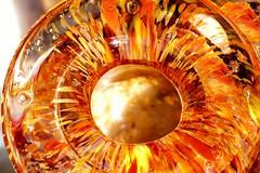 In the eye of the dragon (M. Carpentier) Tags: glassblowing macromondays holes orange trou verre verresoufflé dragoneye oeil