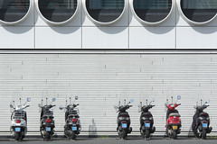 One stolen scooter (Jan van der Wolf) Tags: map171301v seven 7 scooters gevel facade round ravelresidence architecture architectuur amsterdam windows ramen