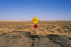 none shall pass. mojave desert, ca. 2011. (eyetwist) Tags: eyetwistkevinballuff eyetwist sign end road pavement asphalt landscape empty mojavedesert california nikon n90s nikkor 28105mmf3545d fuji velvia 50 rvp transparency chrome slide nikonn90s fujivelvia50rvp ishootfilm ishootfuji analog analogue film emulsion coolscan 35mm 28105mm iconla southwest usa dirt horizon mojave desert decay roadsideamerica closed street desolate northedwards dead
