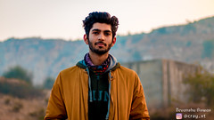 Vasu Chaudhary (Reyan) - An Aspiring Fashion Model (Cray_xt) Tags: jacket confidence curly hair fashionable beautiful people hands pockets future fashion model long tie contemplation performance scarf arms crossed coat promotion standing end aspirations neckwear raised finger lens flare backlit back lit dramatic sky sunrise sun projector business attire overtime sunset hips recreation hiker exploring backpack exercise active fitness mountain healthy living hiking path portrait photography canon 200d
