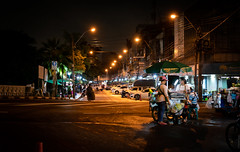 Almost Midnight (dlerps) Tags: bkk bangkok city daniellerps lerps sony sonyalpha sonyalpha99ii tha thai thailand urban lerpsphotography metropolitan night streetphotography street road foodstall people carlzeiss asia asian streetfood planart1450 market carlzeissplanar50mmf14ssm happyplanet asiafavorites