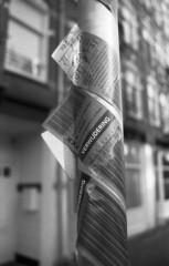 Absolution (Arne Kuilman) Tags: amsterdam nikon fm3a vivitar 28mm luckyshd iso100 id11 7minutes homedeveloped stock analogue film verwijdering sticker fietsen gemeenteamsterdam fietsbeheer stadsdeel