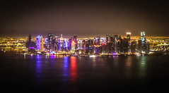 Doha Cityscape (Andy.Gocher) Tags: andygocher canon100d canon100dsigma18250 sigma18250 flying windowseat aeroplaneseat aeroplanewindow aerial middleeast qatar doha city cityscape night reflection water
