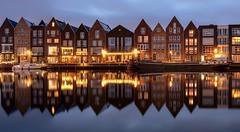 Haarlem on a row (reinaroundtheglobe) Tags: haarlem spaarnestad nederland holland noordholland water hetspaarne reflections waterreflections illuminated bluehour boat