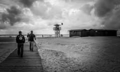 Walk On The Beach (Lea Ruiz Donoso) Tags: beach playa bw blackandwhite people walking walk sky water ocean atlantic cloud sony landscape seascape shoreline storm tarifa
